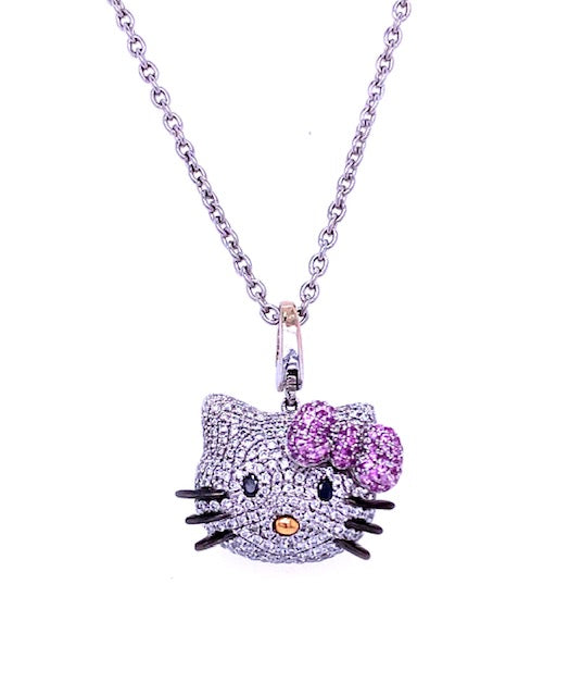 "One of a kind Kitty. This is the ultimate Hello Kitty Pendant Collection for all the fans of this memorable character.   White round diamonds in a pave setting for the cute face 1.20 cts  Round pink sapphires for her bow 0.25 cts  18k yellow gold drop for her nose  Black onyx for eyes & whiskers   18"" long solid chain  Secure lobster clasp  Gallery finish at the back of the pendant  Secure bail to place in any other chain"