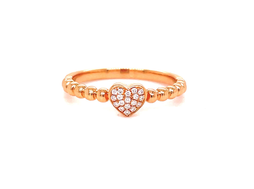 Diamonds 0.04 cts.  Set in 18k rose gold mounting.  Size 6  Heart accent ring  Easy to stack