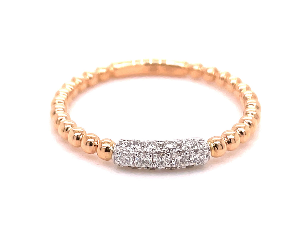 Diamonds 0.17 cts.  Set in 18k rose gold mounting.  Size 6 (sizeable)  Bar diamond ring.  Bead style  Easy to stack