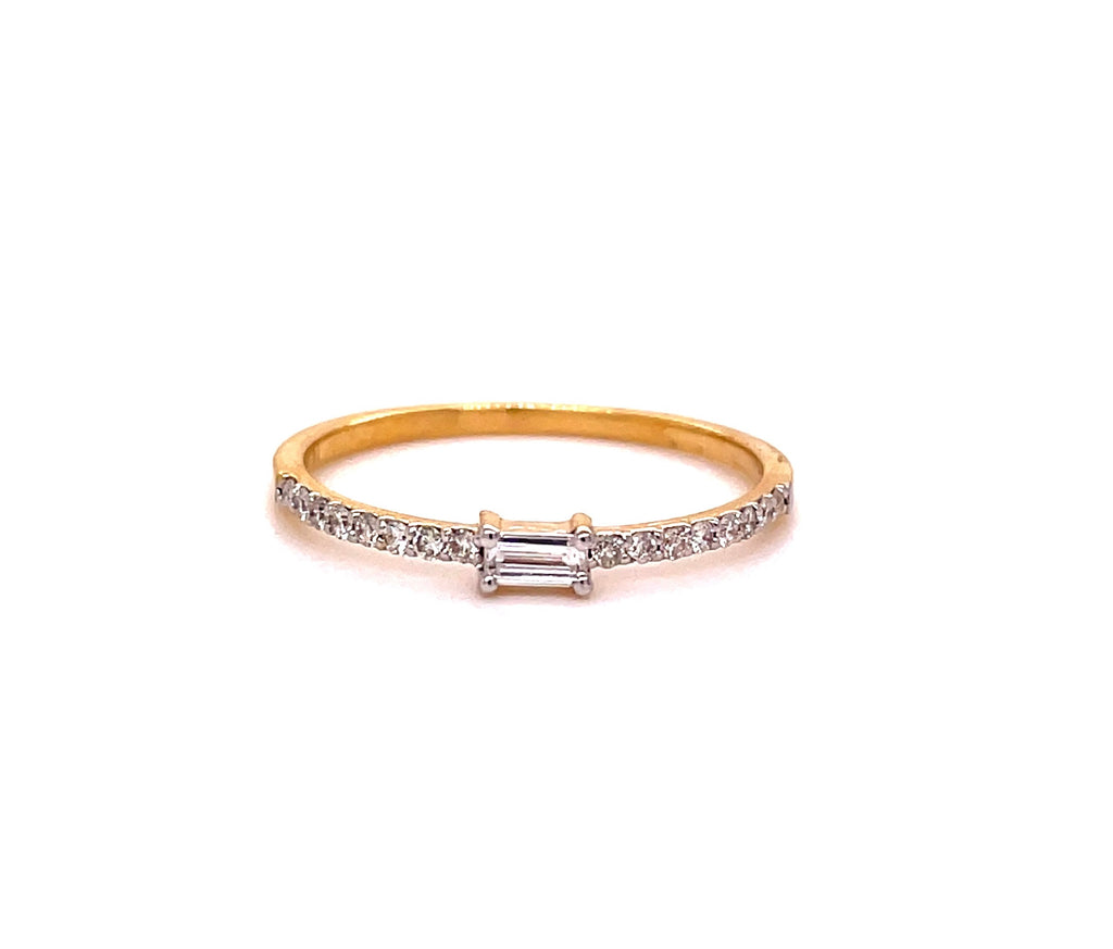 Single baguette & round diamonds 0.18 cts  Set in 14k yellow gold mounting.  Size 6  Easy to stack