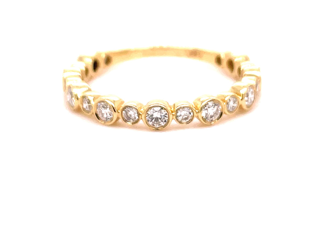 Set in 14k yellow gold  Round diamonds 0.50 cts  Bezel set two size diamonds  Easy to stack