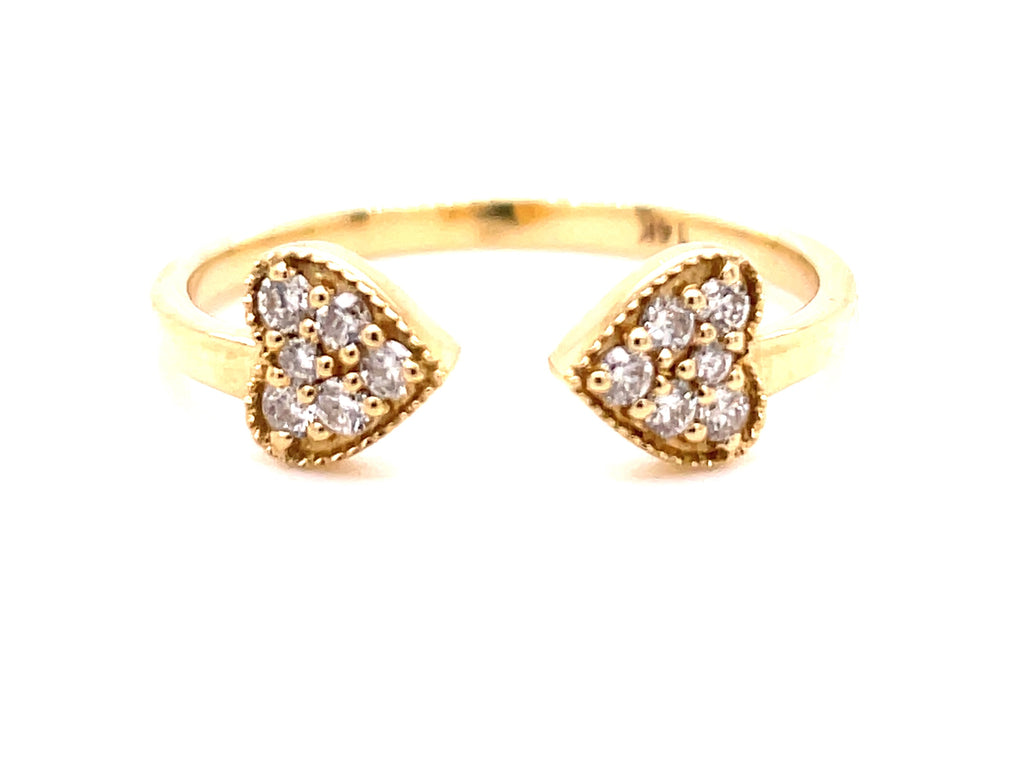 Set in 14k yellow gold  Round diamonds 0.16 cts  Two heart shape   Easy to stack
