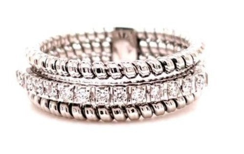 Italian designer Novecento noventanove  Innovated tubogas technique that allows flexibility   Three rows ring.  Classic and contemporary design   Round diamonds  0.16 cts  7.30 mm wide.  6.5 size (sizeable)