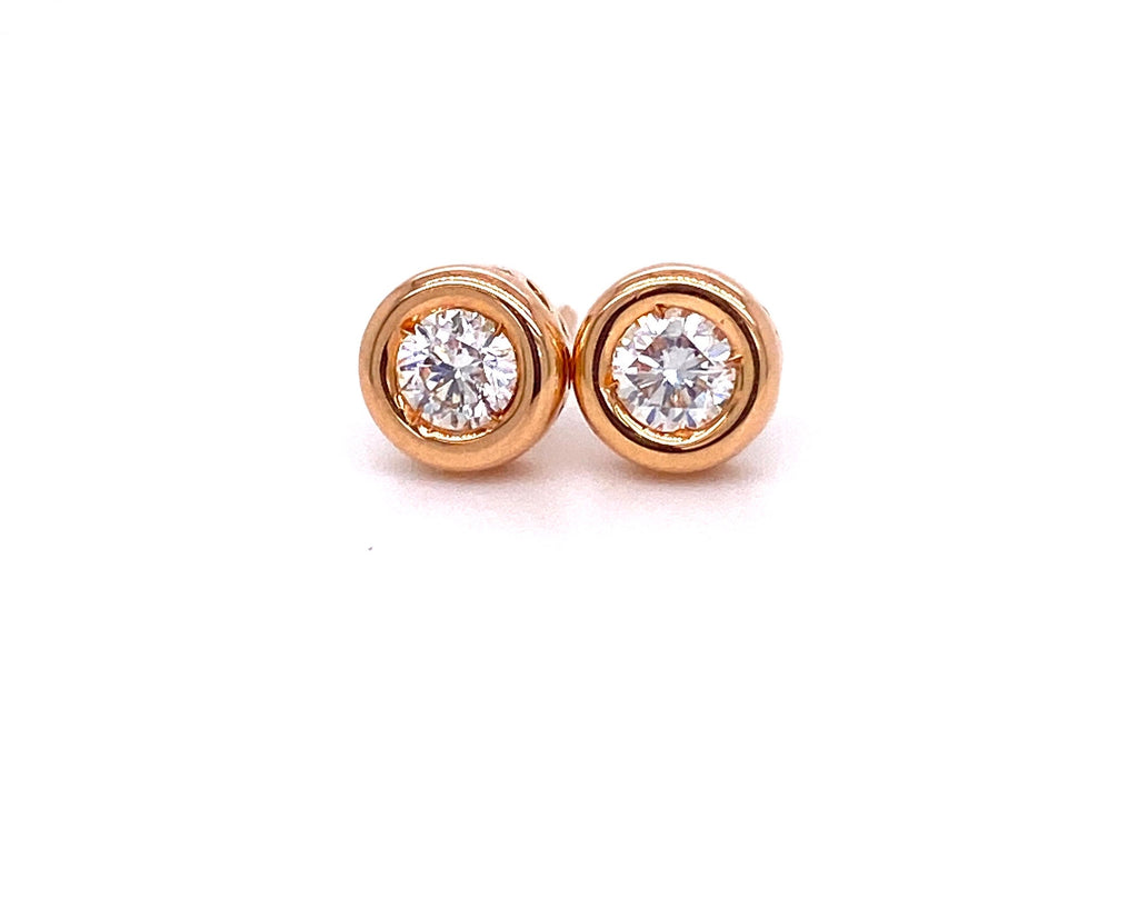 Diamond bezel stud earrings 18k rose gold  Secure friction backs   White round diamonds 0.36 cts  Gallery design on the side of the earring