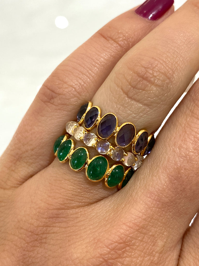 Stackable emerald ring  Set in 18k yellow gold.  Adjustable ring 6-9  Oval cabochon shape   6.0 mm x 5.0 mm size