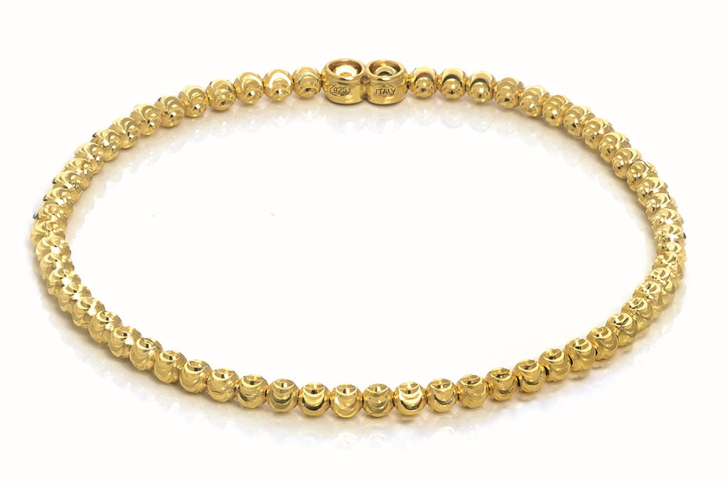 Italian collection from Officina Bernardi  High precision diamond cut 5.00 mm bead  Gold plated  Flexible and stretchable.