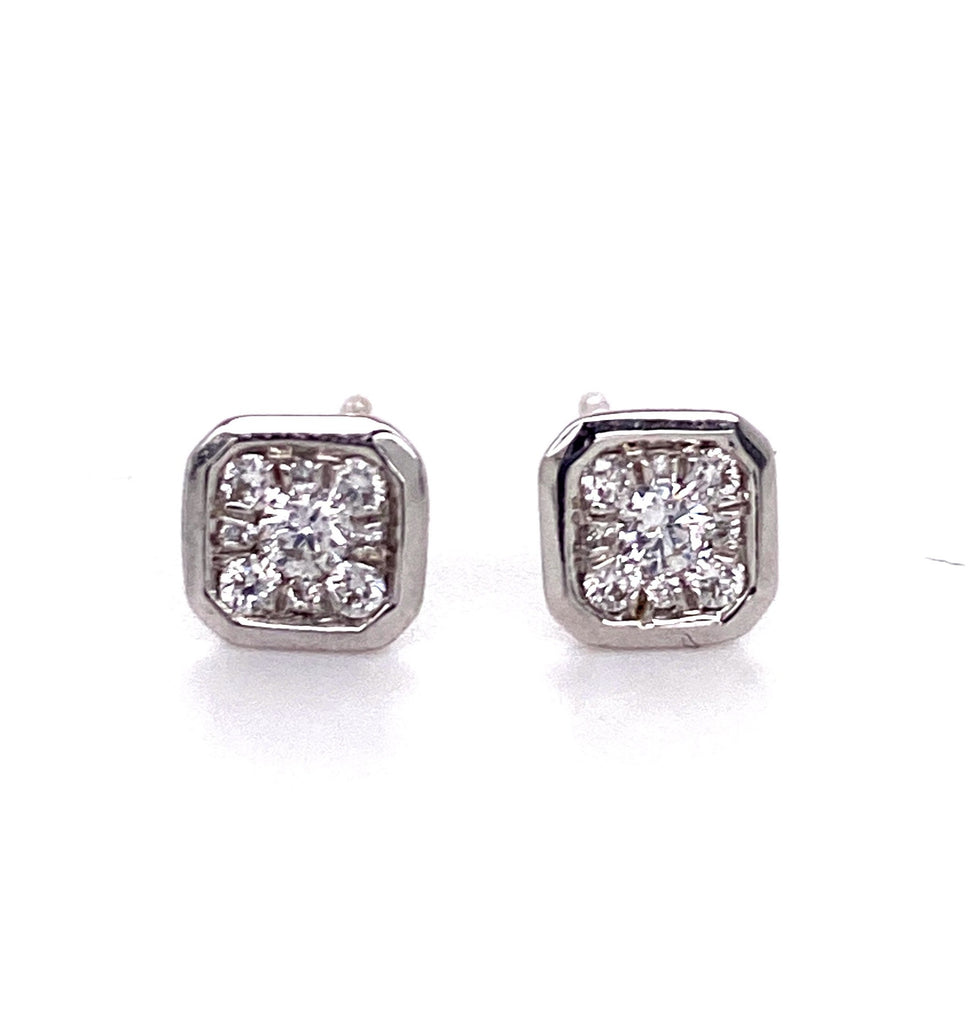 Dainty diamond earrings.   18k white gold  Secure heart shaped friction backs  20 small diamonds 0.30 cts  6.40 mm long
