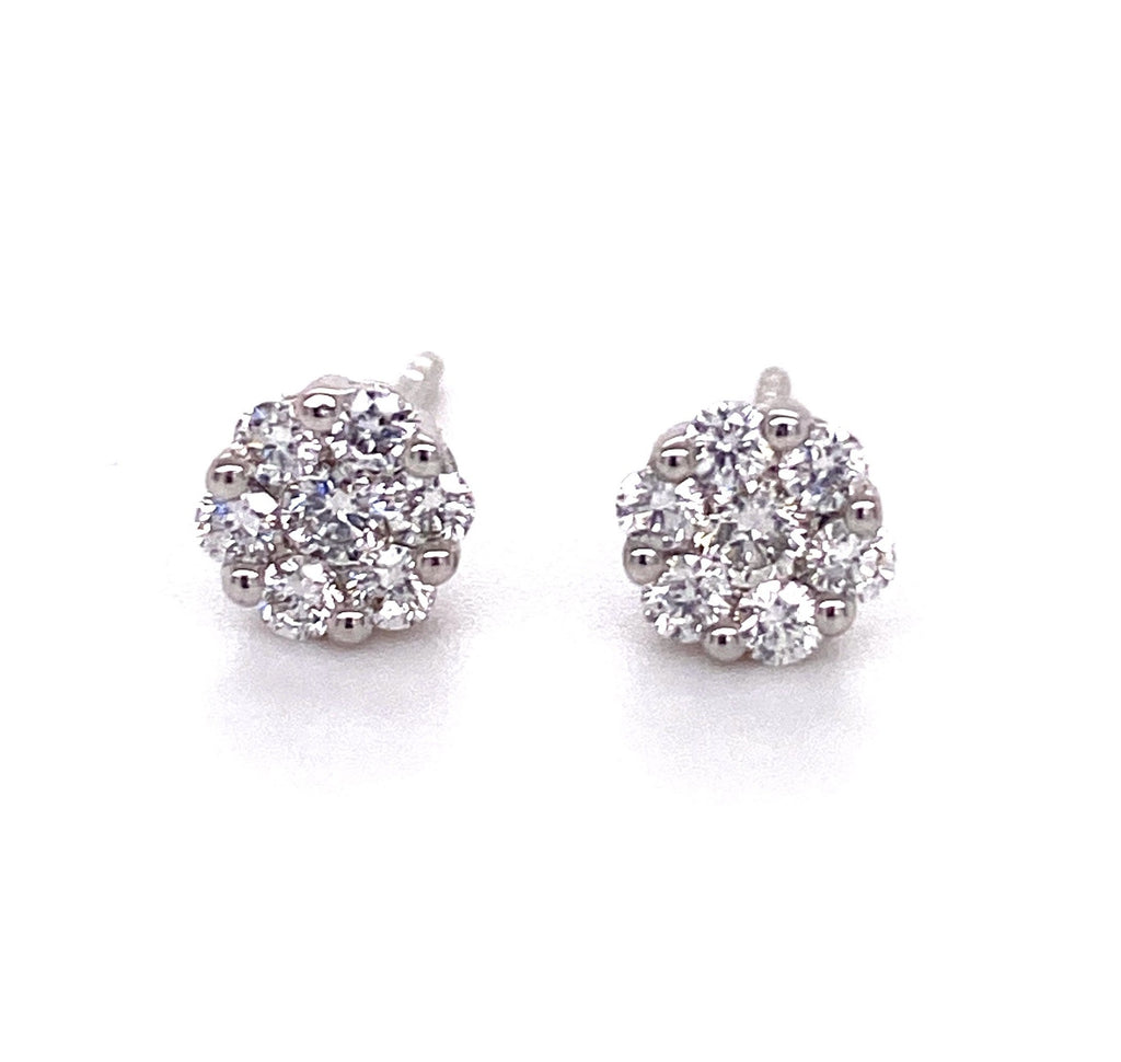 Dainty diamond earrings.   18k white gold  Secure heart shaped friction backs  14 small diamonds 0.35 cts  5.35 mm long