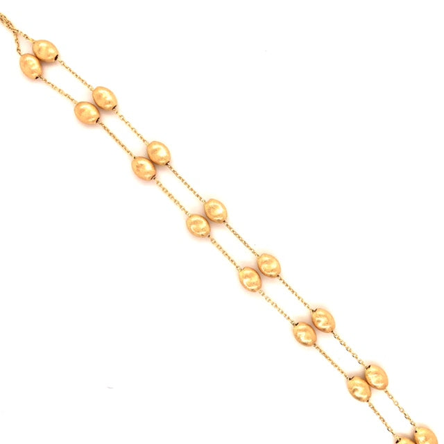 "14k Yellow Gold  Two strands  7"" long  Secure lobster catch.   8 Small pebbles on each strand"