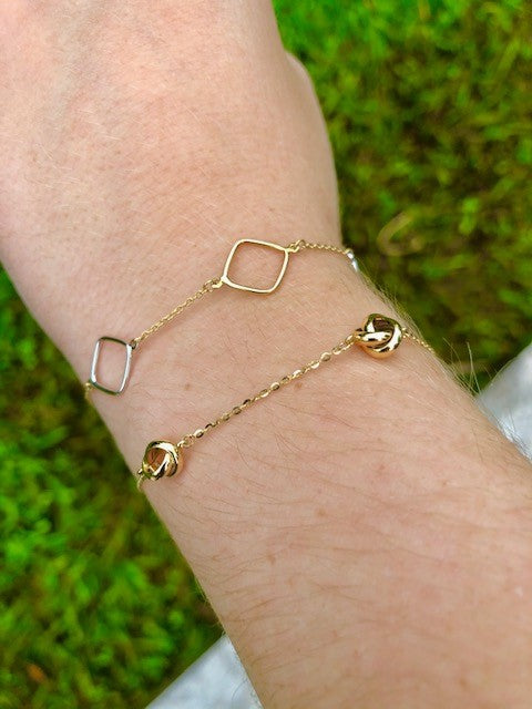 "14k Yellow Gold  Four knots  7"" long  Secure lobster catch   Easy to wear and stack"