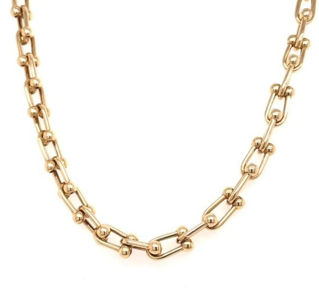 "14k yellow gold.  U link ball.  Secure large spring catch.  21"" long  5.80 mm thickness"