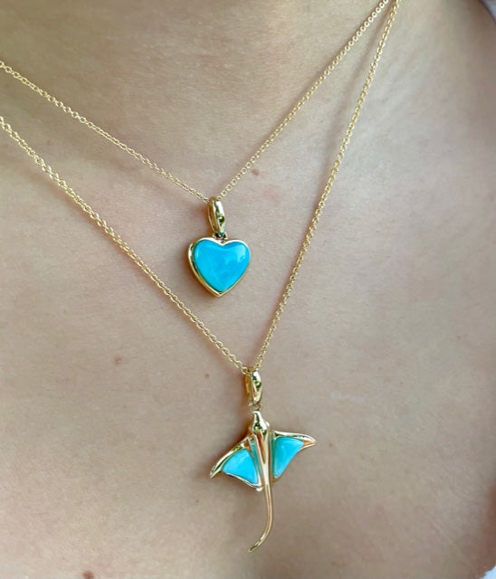 Beautiful stingray pendant.  14k yellow gold  Rare Larimar stone  Secure bail.  35.00 mm length.  1.1 mm gold chain available (optional, not included in price) $199.00