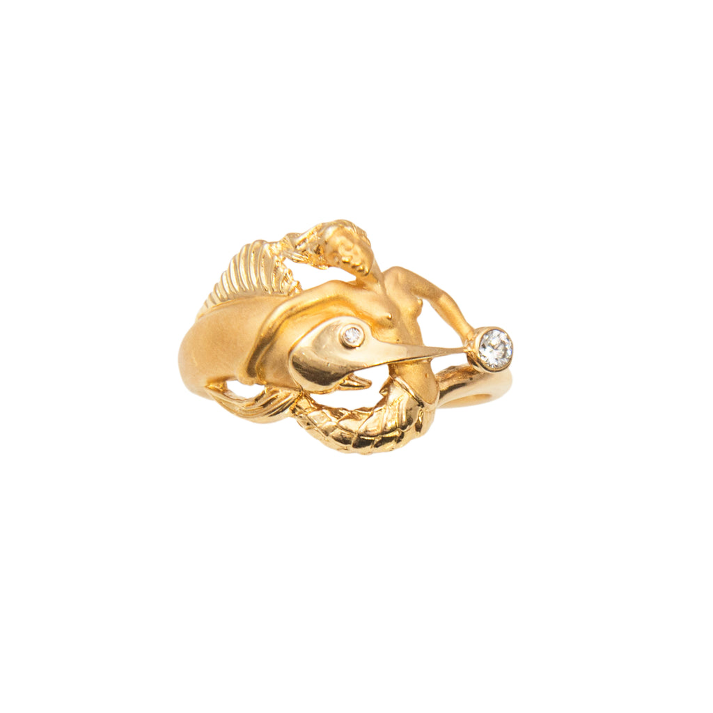 18k yellow gold mermaid and sailfish design, Carrera y Carrera trademark, one round diamond 0.10 cts, matte finish.