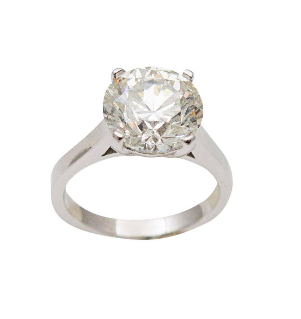 Round brilliant center stone 4.56 cts, H-I, SI-2, set in 14 white gold with four prongs, 5.5 size (sizable)