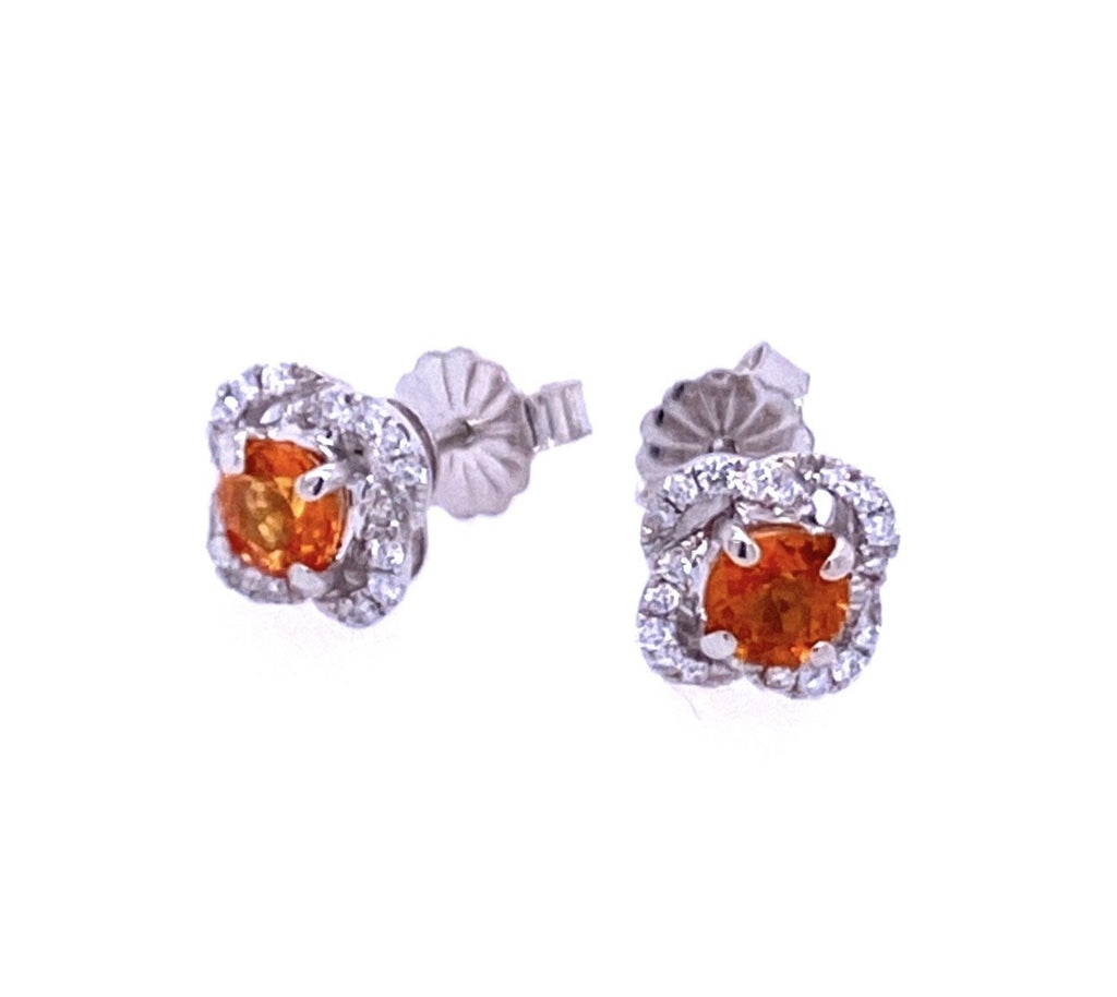 Intense orange sapphires 0.70 cts  White round diamonds 0.17 cts   Set in 18k white gold flower motive mounting  Secure friction backs  7.00 mm