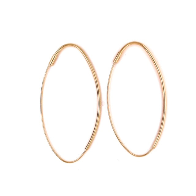 14k yellow gold.  Italian made  Wire back system that creates the illusion of endless hoops  Light weight  54.00 mm long  1.55 mm thickness