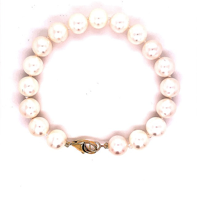 Cultured pearl bracelet  14k yellow gold medium size clasp  7.5' long  9.00 mm   Good luster
