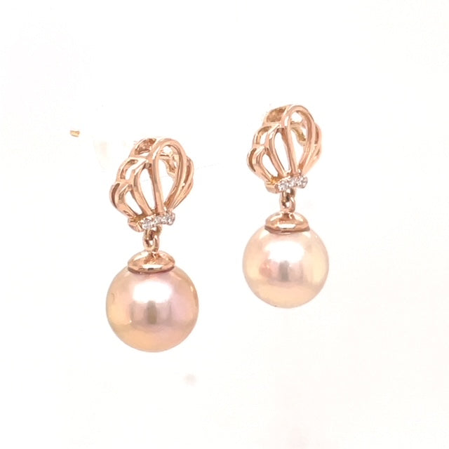 Two Cultured Pearls  6.00 mm  Set in 14k Rose Gold  Secure friction Backs  Round diamonds