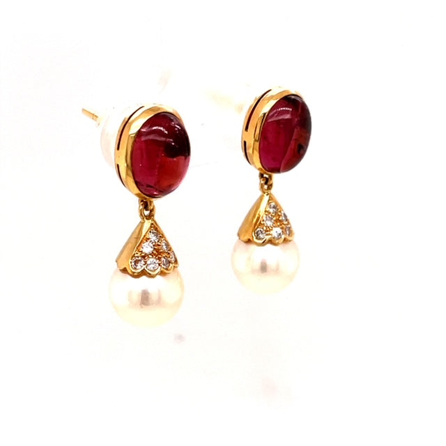 Two Cultured Pearls  Cabochon tourmaline  Set in 18k Yellow Gold  Secure friction Backs  Round diamonds