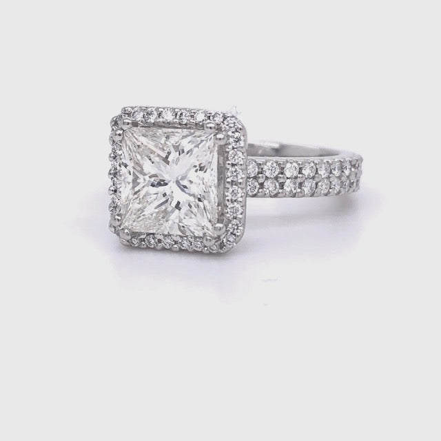 The perfect princess cut ring!  Center stone:  2.30 cts  Color I/J  Clarity SI2  Set in a platinum mounting with double row of round diamonds 0.50 cts   Size 5.5 (sizable)  GIA certified.