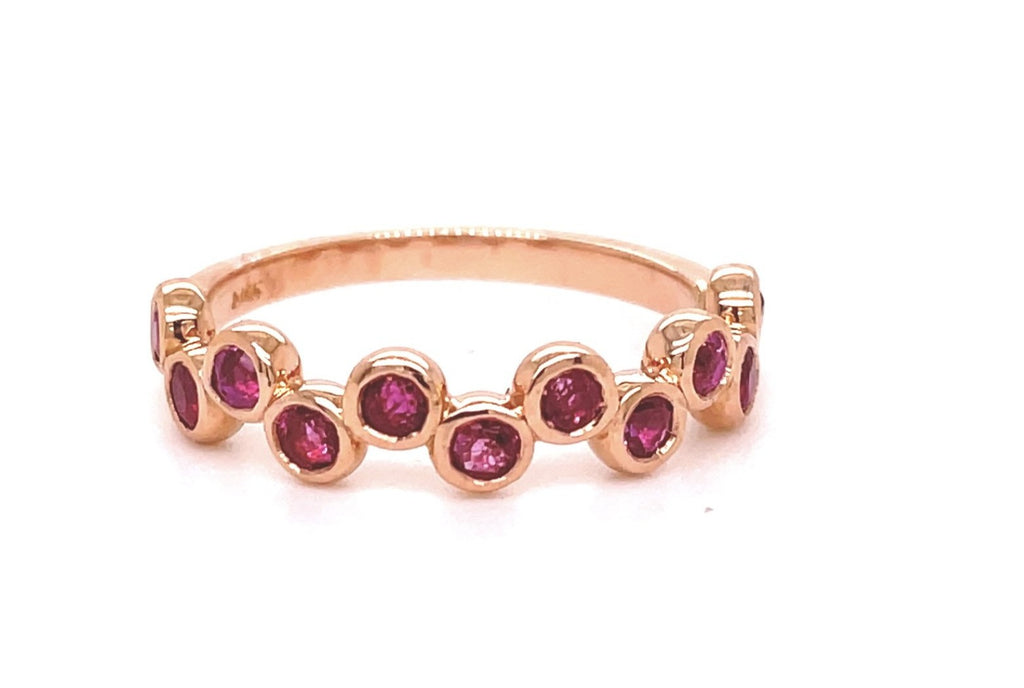 Dainty stackable ring   Set in 14k rose gold  12 round pink sapphires 0.60 cts  Bezel set  Size 7 (sizeable)