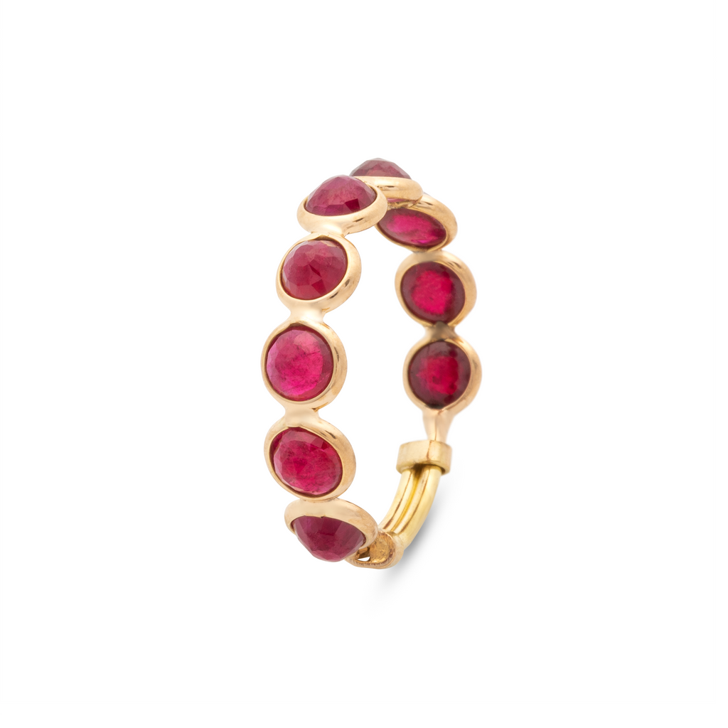 Set in 18k yellow gold.   Size 6-9  8 facet rubies 5.00 mm size.