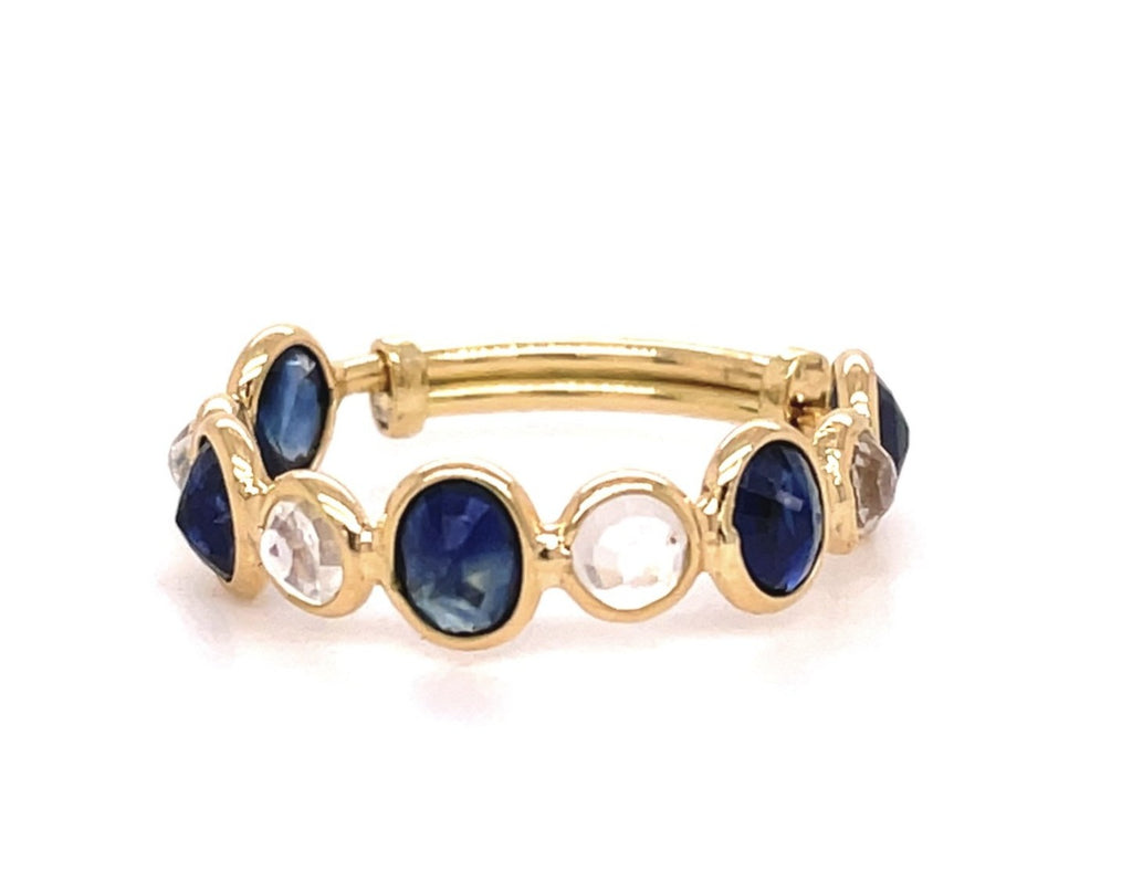 Set in 18k yellow gold.   Adjustable shank       Size 6-9  4 facet oval sapphire stones 5.20 mm   4facet round moonstone stones 3.80 mm