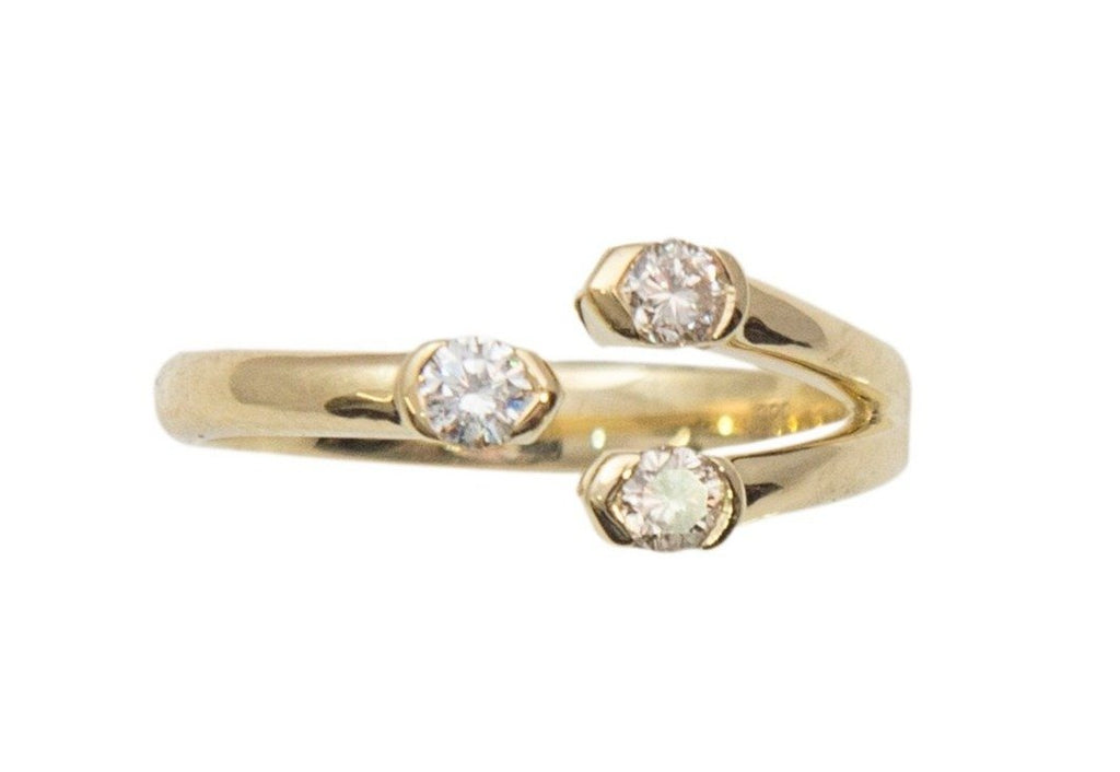From Cherie Dori collection comes this modern and beautiful free form three stone ring. Three round diamonds 0.25 cts. 14k yellow gold.