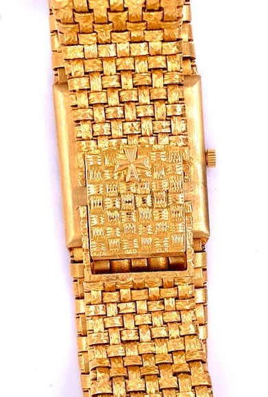 Gold hour markers  Gold dial   18k yellow basket pattern integrated bracelet with clasp  Good working condition  Automatic watch