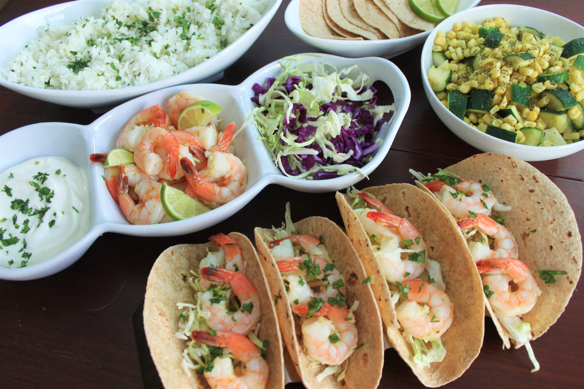 Shrimp Tacos with Creamy Cumin Crema and Slaw