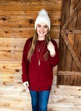 Distressed wine sweater