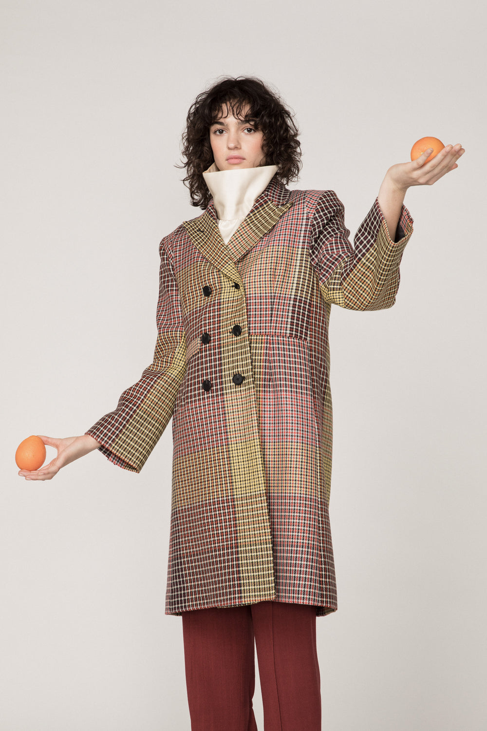 Rosie Assoulin Pre-Fall 2019 Classic Car Coat. Utilitarian double-breasted woven coat. Notched label. 3-button closure. Multicolored plaid. 100% Virgin Wool. Sizes 0 - 12.