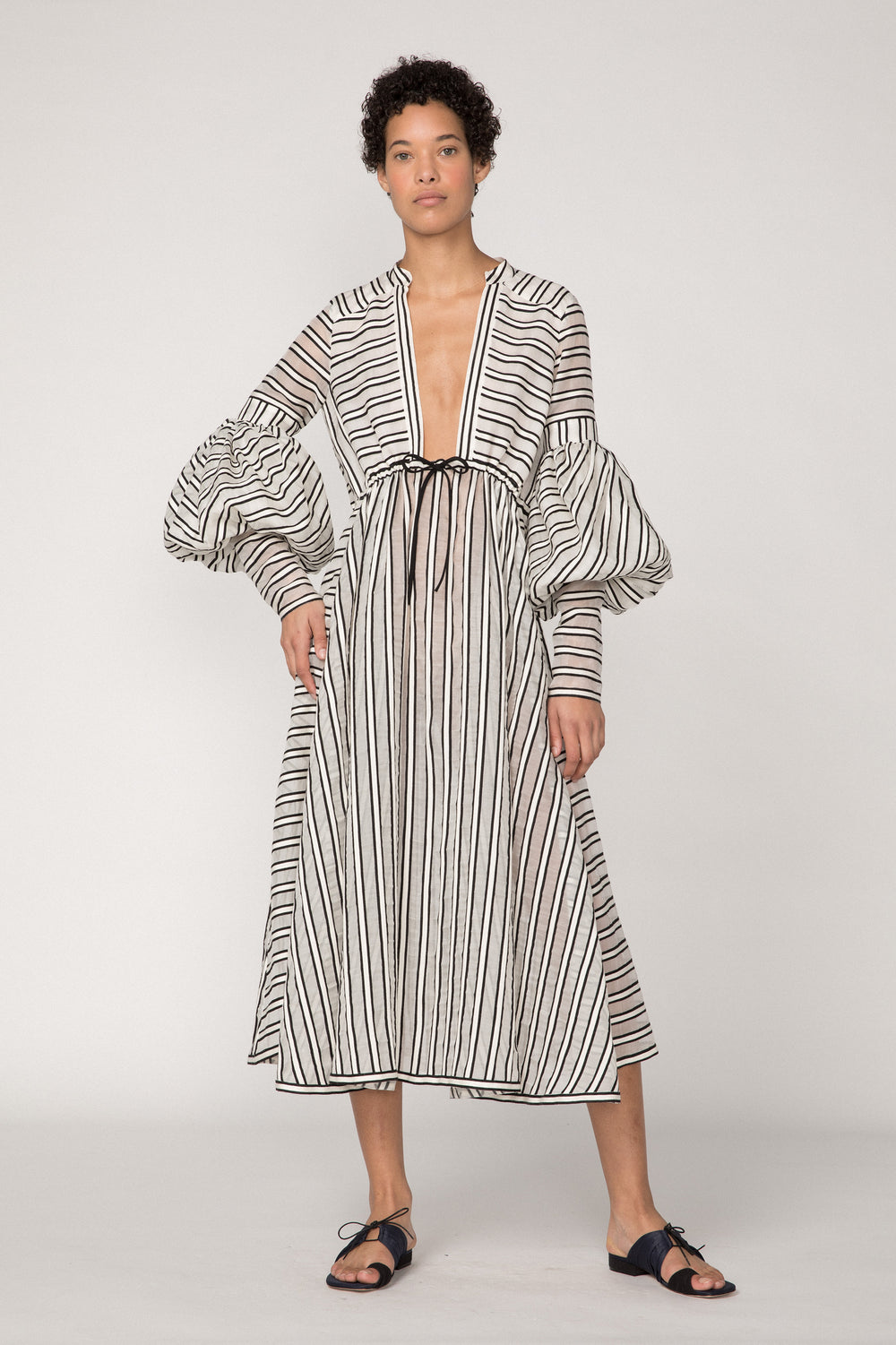 Rosie Assoulin Pre-Fall 2019 Lantern Sleeve Dress. Long sleeve midi dress. Plunging neckline. Hook and eye closures. Voluminous sleeves. Black stripe. 77% Virgin Wool, 23% Silk. Sizes 0 - 14.