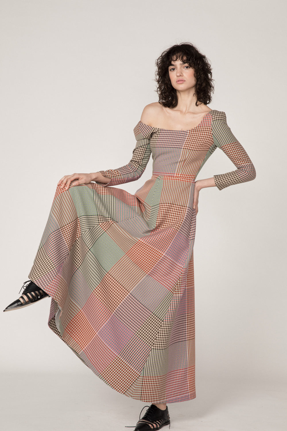 Rosie Assoulin Pre-Fall 2019 Off Ya Shoulder Dress. Long sleeve A-line dress. Slight shoulder pads. Customizable neckline. Zipper in back. Multicolored plaid. 100% Polyester. Sizes 0 - 12.
