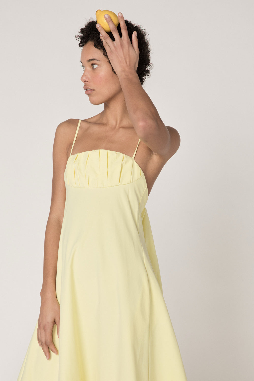 Rosie Assoulin Pre-Fall 2019 Cami Ruffle Hem Dress. Fluted cami dress. Empire waist. Ruffle hem. Low back. Pockets. Yellow. 100% Cotton. Sizes 0 - 12.