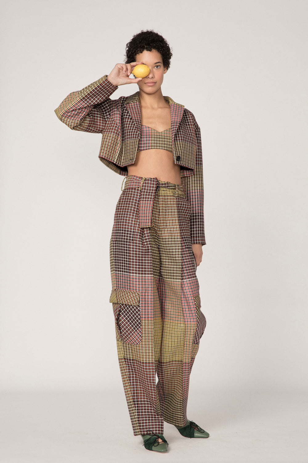 Rosie Assoulin Pre-Fall 2019 Belted Cargo Pant. High-waisted classic cargo pant. Four extra-large side pockets. Hook closures. Removable belt with buckle. Multicolored plaid. 100% Virgin Wool. Sizes 0 - 12.