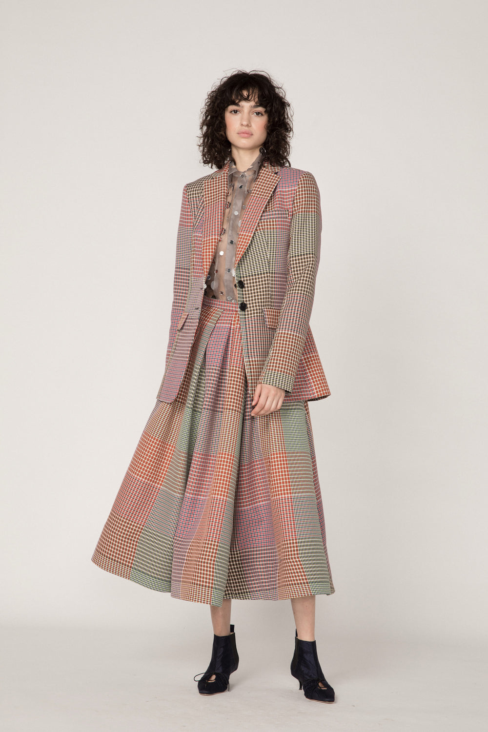 Rosie Assoulin Pre-Fall 2019 Classic Blazer. Classic tailored blazer. Notched lapel. Two front button closures. Accentuated waist. Two flap patch pockets. Multicolored plaid. 100% Polyester. Sizes 0 - 12.