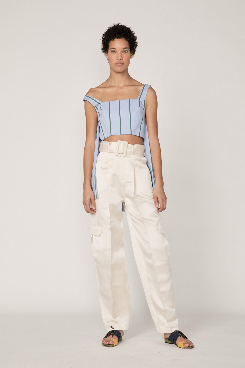 Rosie Assoulin Pre-Fall 2019 Belted Cargo Pant. High-waisted classic cargo pant. Four extra-large side pockets. Hook closures. Removable satin belt. White. 100% Silk. Sizes 0 - 12.