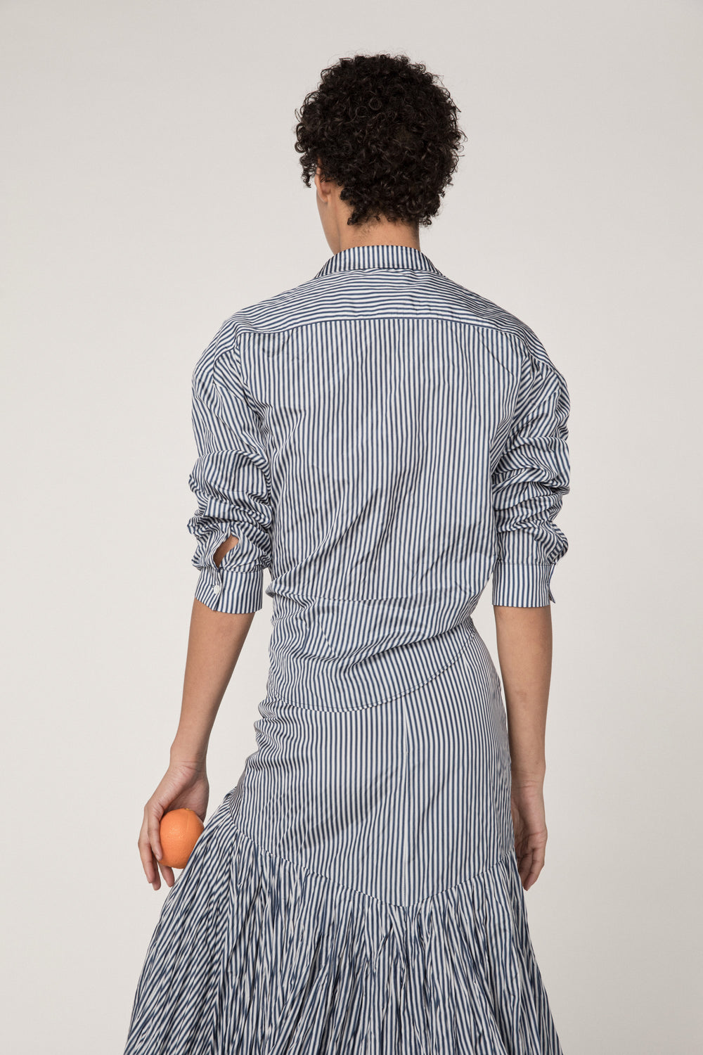 Rosie Assoulin Pre-Fall 2019 Reversible Classic Tie Front Shirt. Reversible button down. Relaxed fit. Adjustable ties. Navy stripe. 100% Polyester. XS - L.