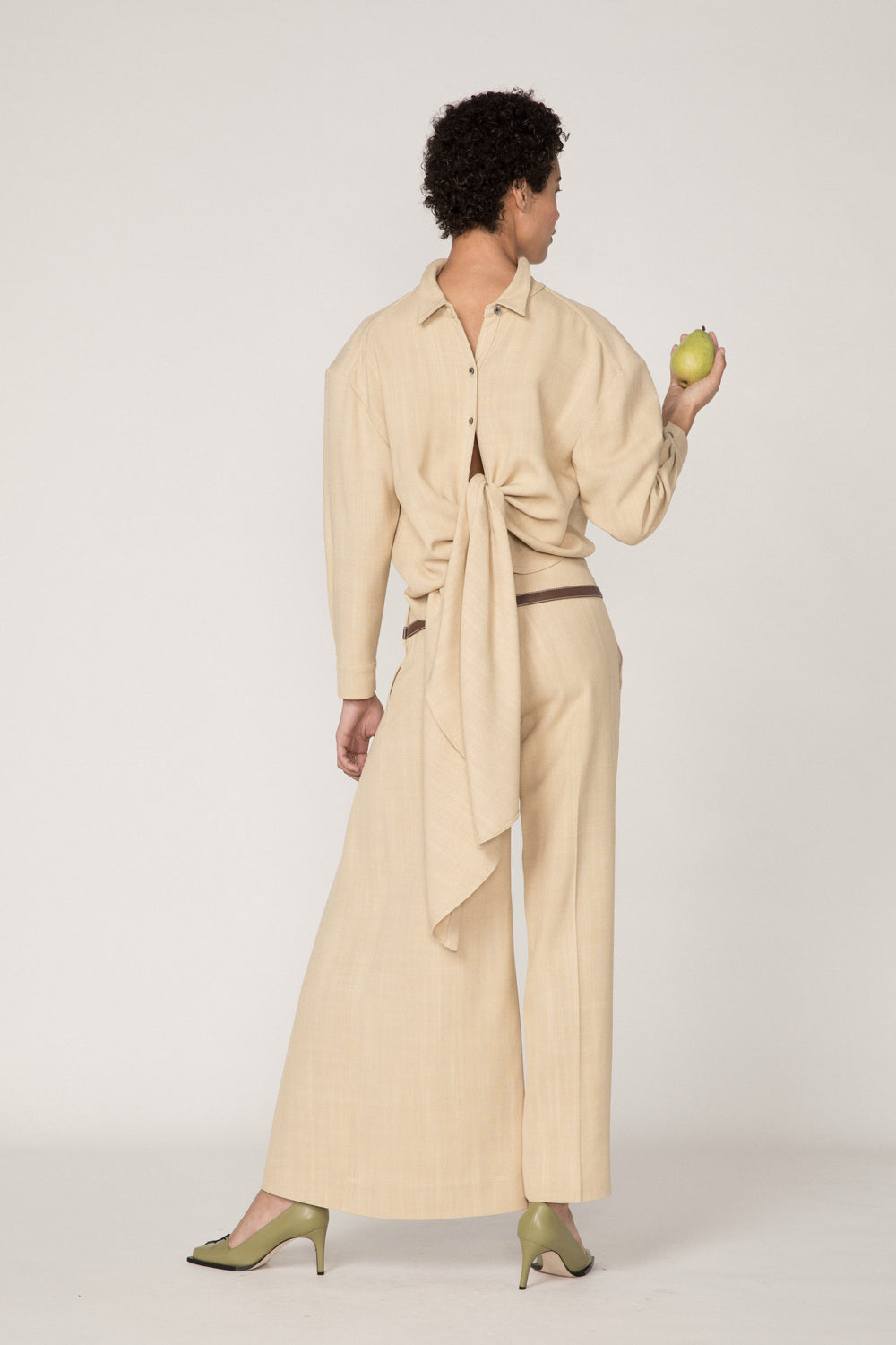Rosie Assoulin Pre-Fall 2019 Criss Cross Applesauce Pant. Relaxed fit pant. Faux leather ribbons. Asymmetrical slit. Cream. 100% Viscose. Sizes 0 - 12.