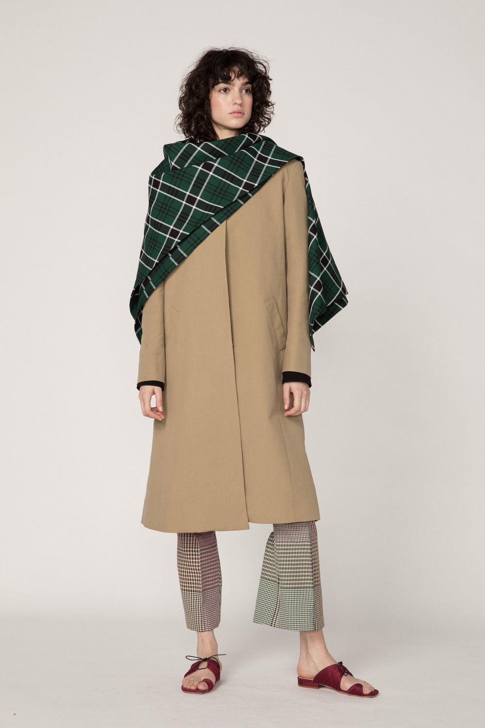 Rosie Assoulin Fall 2019 Shawl Coat. Khaki coat with draped shawl. High neck. Collarless. Split seam in back. Khaki. 100% Cotton. Sizes 0 -12.
