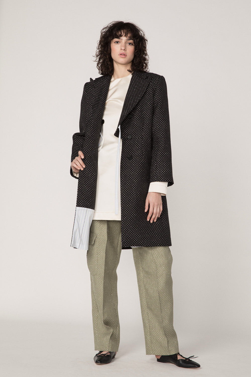 Rosie Assoulin Fall 2019 Classic Car Coat. Utilitarian double-breasted woven coat. Notched label. 3-button closure. Black. 66% Polyester, 34% Cotton. Sizes 0 - 12.