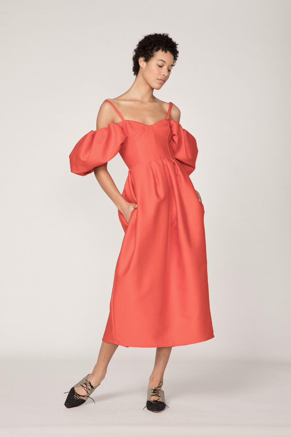 Rosie Assoulin Fall 2019 Off the Shoulder Puff Sleeve Cocktail Dress. Mid-length cocktail dress with puff sleeves. Ruched skirt. Split seam on rear hem. Center back zipper. Red. 100% Cotton. Sizes 0 - 12.