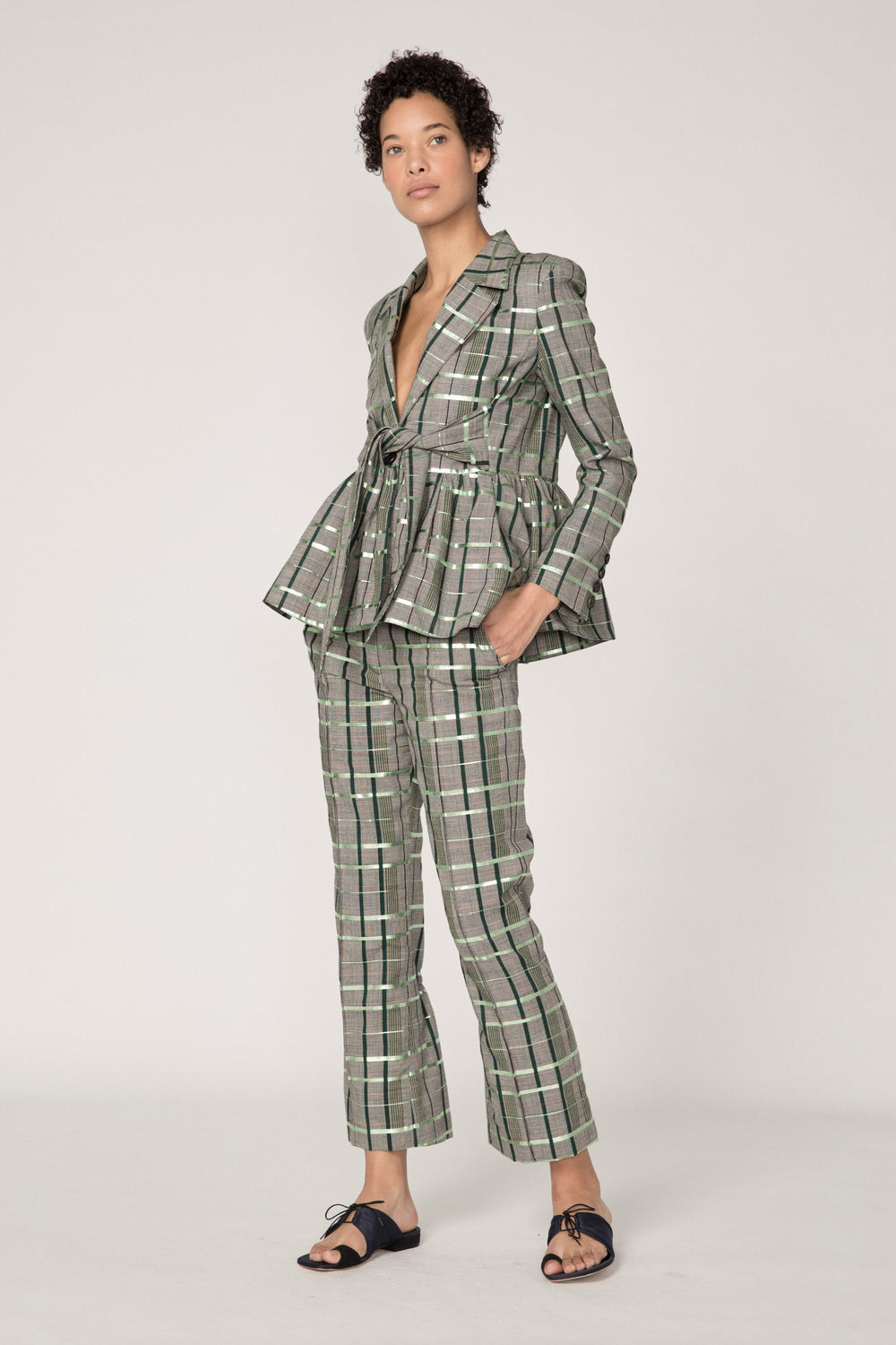 Rosie Assoulin Fall 2019 Scrunchy Pant. Straight leg cropped pant. Elastic behind the knee. Soft flare. Pockets. Finished with metallic foil. Green plaid. 98% Wool, 2% Polyester. Sizes 0 - 12.
