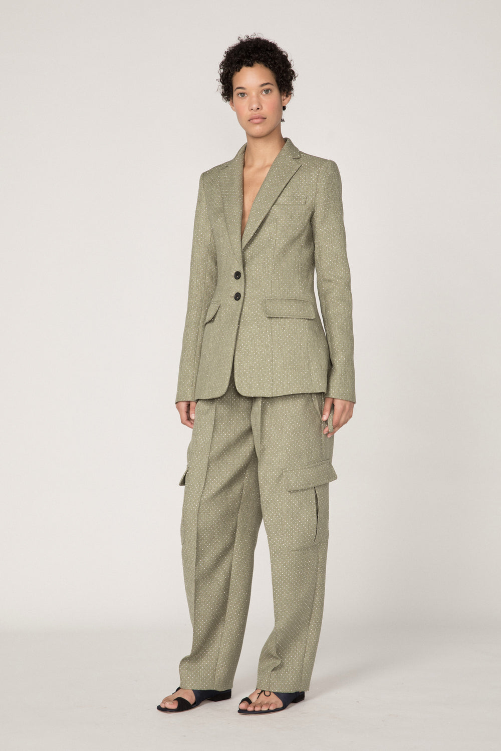 Rosie Assoulin Fall 2019 Classic Blazer. Classic tailored blazer. Two front buttons. Two flap patch pockets. Slight flare. Green. 66% Polyester, 34% Cotton. Sizes 0 - 12.