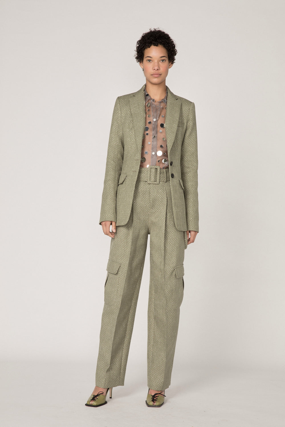 Rosie Assoulin Fall 2019 Belted Cargo Pant. High-waisted cargo pant. Four extra-large side pockets. Hook closures. Removable belt. Green. 66% Polyester, 34% Cotton. Sizes 0 - 12.