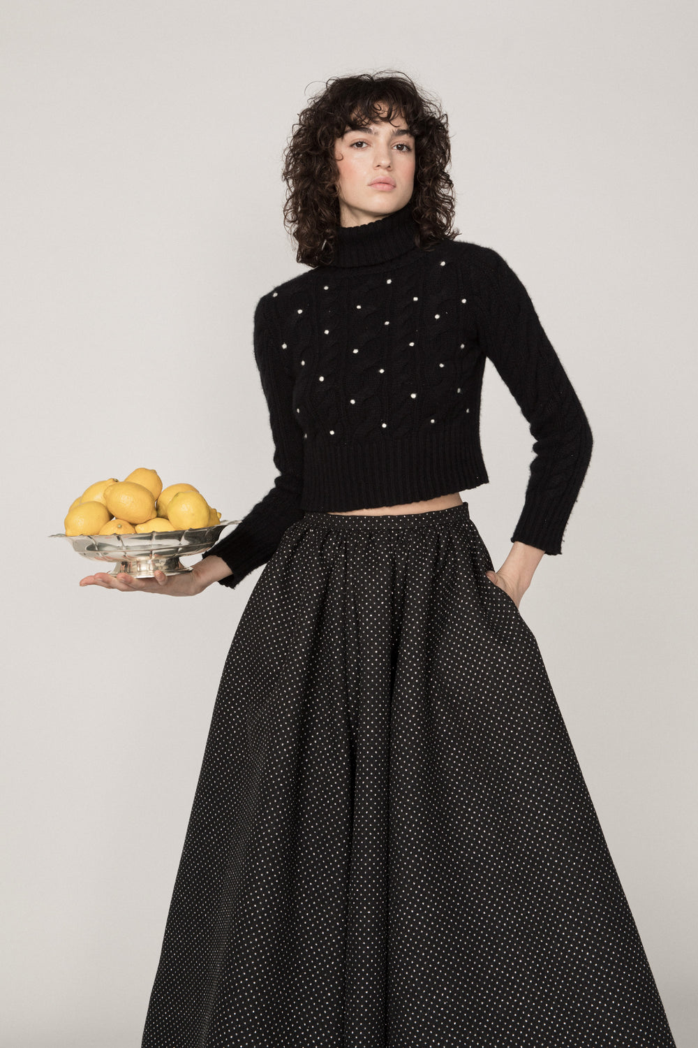 Rosie Assoulin Fall 2019 Knit Polka Dot Turtleneck Sweater. Cozy cashmere turtleneck. Needle-felted polka dots. Sim fit. Cropped cut. Black. 100% Cashmere. Sizes XS - L.