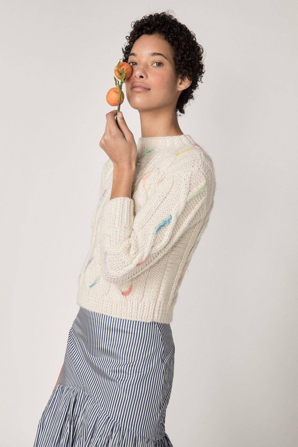 Rosie Assoulin Fall 2019 Knit Brush Stroke Sweater. Traditional cableknit sweater. Needle-felted pastel brush detail. Slim fit. Cream. 100% Baby Alpaca Wool. Sizes XS - L.