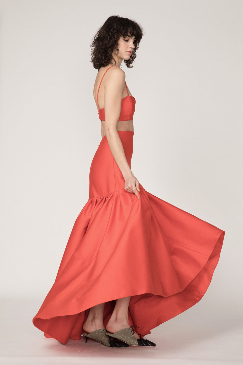 Rosie Assoulin Fall 2019 Brush Skirt. High-waisted ball skirt. High-low hemline. Dramatic flare. Ruched bottom. Red. 100% Cotton. Sizes 0 - 12.