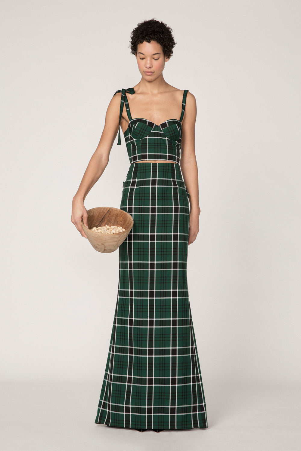 Rosie Assoulin Fall 2019 Bustino. Cropped bustier top. Bow on right shoulder. Hook and eye closure in back. Green plaid. 100% Polyester. Sizes 0 - 12.